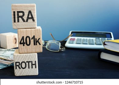 Cubes with words IRA, 401k and ROTH. Retirement plan.