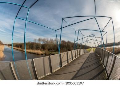 Cubic Bridge in the Netherlands, city Zoetermeer (Balijbos). Bicycle Bridge