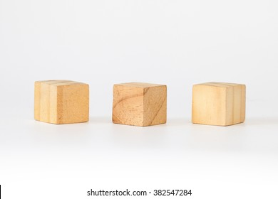 Cubic Wooden toy blocks on white background