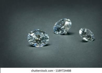 Cubic zirconias looking like a diamonds on dark background.