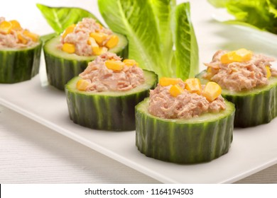 Cucumber appetizers with tuna paste and corn