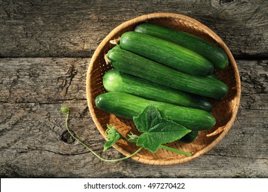 Cucumber basket on wooden background