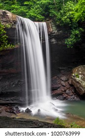 Cucumber Falls, a beautiful waterfall in Pennsylvania's Ohiopyle State Park, plunges over an overhanging woodland cliff.