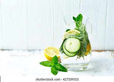 Cucumber and Lemon Detox Water. Homemade detox drink. Symbolic image. Healthy diet and lifestyle. White wooden background. Copy space.