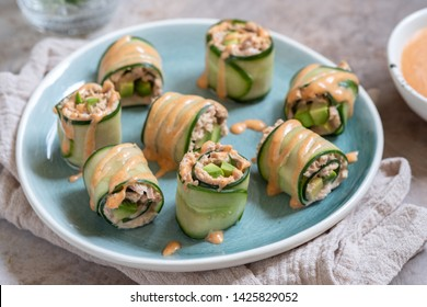 Cucumber roll with tuna, avocado and mayo chili sauce