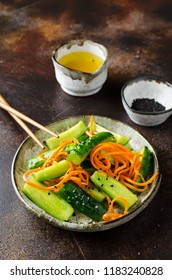 Cucumber salad with carrots and sesame seeds. Asian cuisine