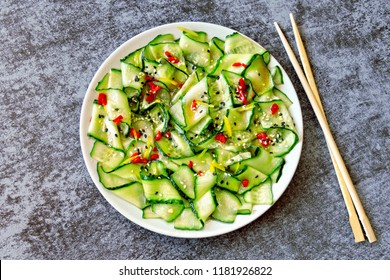 Cucumber salad in Chinese style. Salad with cucumbers and chili pepper. Chinese salad with cucumber.