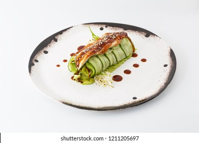 cucumber salad roll with acne in a white plate isolated on white background.