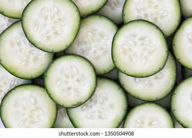 Cucumber slices filling frame for food background.