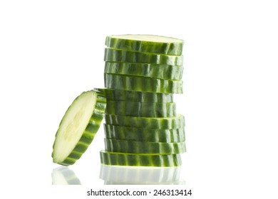 Cucumber slices on a white background