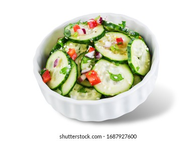 Cucumber spice salad with red onion nd red pepper on a white isolated background. toning. selective focus