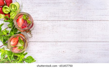Cucumber and strawberry detox water .