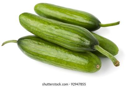 cucumbers heap against white background