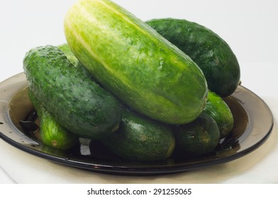 Cucumbers on brown plate