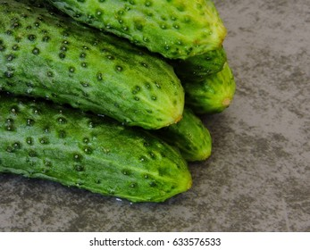 Cucumbers on a gray background. Macro. Copy space.