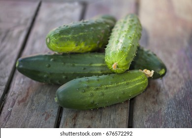 Cucumbers on a old wooden table.