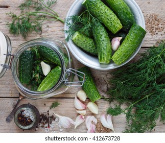 Cucumbers for pickling. Fresh cucumbers ready for canning with dill, garlic and spices.  Selective focus