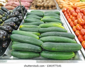 cucumbers for sale in supermarket in the section of hortifruti, with background unfocused