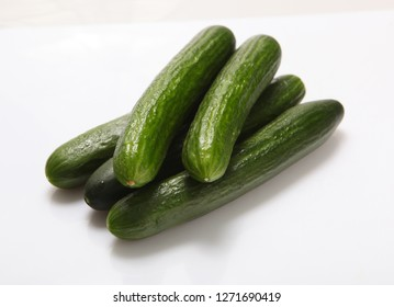 Cucumbers smooth, fresh, on a white background.