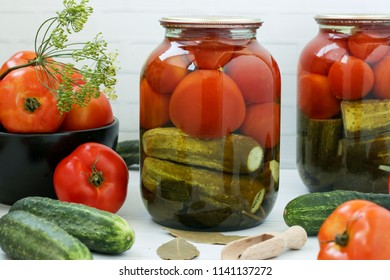 Cucumbers and tomatoes marinated in jars. Harvest for the winter.
