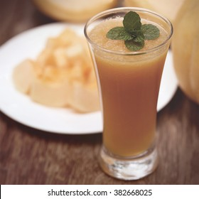 Cucumis Melo or Muskmelon on a plate and juice