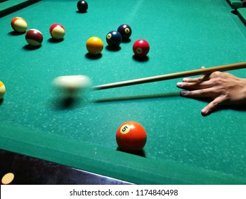 Cue aim billiard snooker pyramid on green table. A Set of snookers/pool balls on Billiards table.