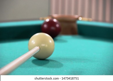 Cue, two billiard balls on a green cloth table, cue ball and white ball, selective focus. framing, Russian Billiards