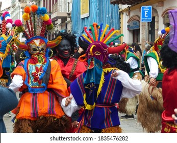 Cuenca, Ecuador - December 24, 2016: Dancers dressed as characters of Inti Raymi celebration called Diablo Huma (Devil) at the annual Pase del Nino Christmas parade at historic center of city Cuenca