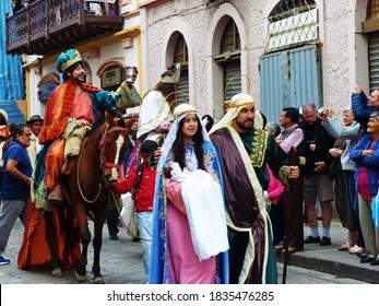 Cuenca, Ecuador- December 24, 2016: Parade Paseo del Nino Viajero, heritage of UNESCO. Couple as Holy family: Joseph and Mary with baby Jesus