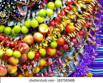 Cuenca, Ecuador- December 24, 2016: Parade Paseo del Nino Viajero in Cuenca. Close up of horse's decoration for parade: candy, fruit, toys, flowers, details of skirt with embroidery