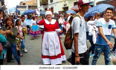 Cuenca, Ecuador - December 24, 2017: Woman dressed as Santa Claus or Papa Noel in Paseo del Nino parade