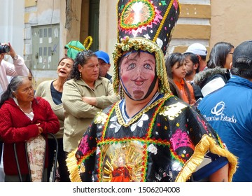 Cuenca, Ecuador - December 24, 2018: Christmas parade Pase del Nino Viajero (Traveling Child) in honor of baby Jesus. Personage of parade in mask