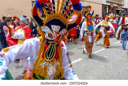 Cuenca, Ecuador - December 24, 2018: Dancers dressed as characters of Inti Raymi celebration called Diablo Huma (Devil) at the annual Pase del Nino Christmas parade at historic center of city Cuenca