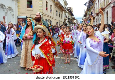 Cuenca, Ecuador - December 24, 2018: Christmas parade in Cuenca city Pase del Nino Viajero in honor of baby Jesus. Participantes as Holy Mary and Joseph with Christ baby doll and group of dancers