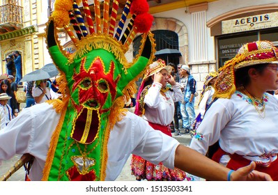 Cuenca, Ecuador - December 24, 2018: Dancer dressed as character of Inti Raymi celebration called Diablo Huma (Devil) at the annual Pase del Nino Christmas parade at historic center of city Cuenca