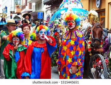 Cuenca, Ecuador - December 24, 2018: Christmas parade Pase del Nino Viajero (Traveling Child). Clowns in colorful costumes among the paticipiantes and horses