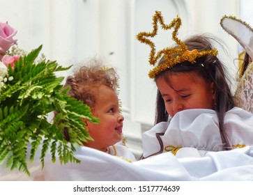 Cuenca, Ecuador - December 24, 2018: Christmas parade Paseo del Nino Viajero (Traveling Child) in honour of baby Jesus. Little children, boy and girl, as angels