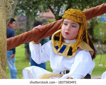 Cuenca, Ecuador - December 31, 2017: Christmas parade Pase del Nino Viajero (Traveling Child). Little girl dressed up for parade as egypt princess
