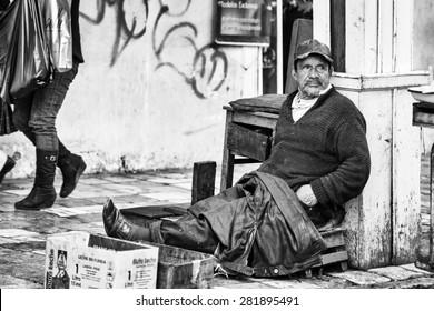 CUENCA, ECUADOR - JAN 9, 2015: Unidentified Ecuadorian man sits in the street. 71,9% of Ecuadorian people belong to the Mestizo ethnic group
