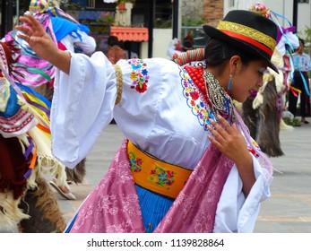 Cuenca, Ecuador - July 21, 2018: Dance Folk Festival in Cuenca, Azuay province. Dancer woman  in traditional costumes of Caniar province. Ecuadorian dancers
