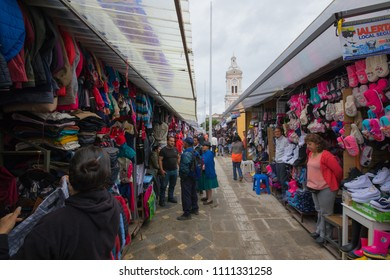Cuenca Ecuador May 2018 city dwellers and tourists regularly visit the clothing market to make purchases or for simple curiosity