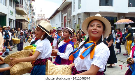 Cuenca, Ecuador-April 11, 2019: Folk dancers represent variety of Ecuadorian culture in traditional dress of cuencano, canari, saraguro, cayambe, otavalo, Tsáchila and Achuar, afro-ecuadorian group