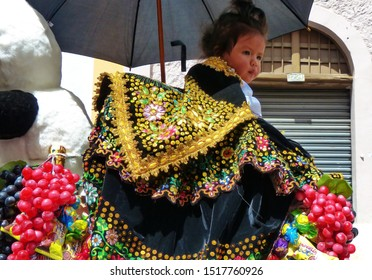 Cuenca, Ecuador-December 24, 2018: Christmas parade Paseo del Nino Viajero (Traveling Child). Little girl dressed up for parade in embroidered costume riding decorated horse