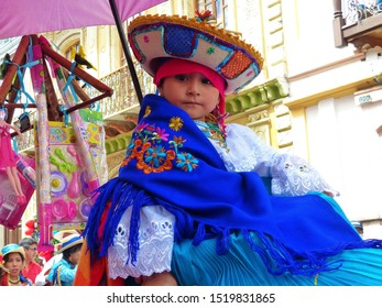 Cuenca, Ecuador-December 24, 2018: Christmas parade Paseo del Nino Viajero (Traveling Child). Little girl dressed up for parade in costume of cayambe  nationality