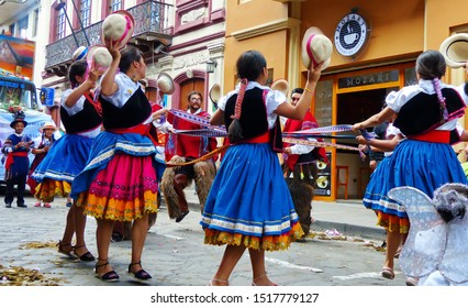 Cuenca, Ecuador-December 24, 2018: Group of dancers in typical dress of azuay province dancing in the streets traditional dance with ribbons during a parade Paseo del Nino Viajero, heritage of UNESCO.