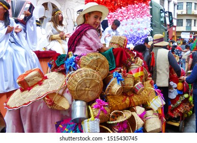 Cuenca, Ecuador-December 24,2018:Christmas parade Paseo del Nino Viajero. Girl dressed up for parade in colorful embroidered costume riding horse decorated with craft, baskets and hats made from straw