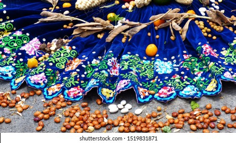 Cuenca, Ecuador-September 28,2019: Fragment of Chacana or Ceremony in homage to Pachamama (Mother Earth) is an aboriginal ritual of the indigenous peoples of central Andes. Beans, corn, fruit on skirt