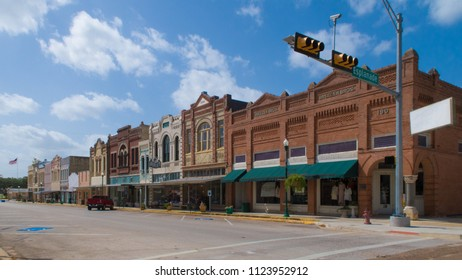 CUERO, TEXAS - JUNE 10 2018: a row of buildings from around 1900 lining a street in Texas