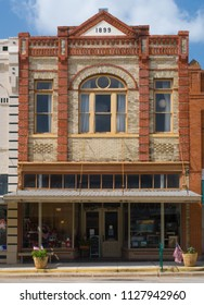 CUERO, TEXAS - JUNE 10 2018: built in 1899, this brick structure shows a very high state of ornamention