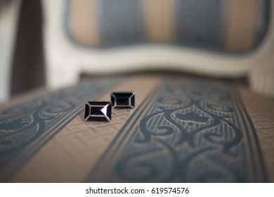 Cuff Links on a fancy chair, Black and silver cuff links